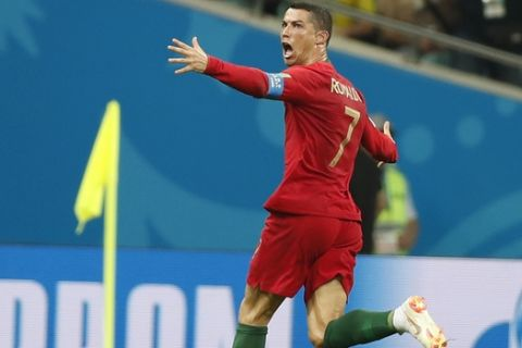 Portugal's Cristiano Ronaldo celebrates his side's equalizing goal during the group B match between Portugal and Spain at the 2018 soccer World Cup in the Fisht Stadium in Sochi, Russia, Friday, June 15, 2018. (AP Photo/Francisco Seco)