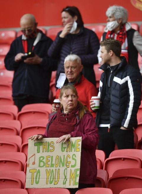Manchester United fans inside the stadium before the English Premier League soccer match between Manchester United and Fulham at Old Trafford stadium in Manchester, England, Tuesday, May 18, 2021. (AP Photo/Paul Ellis, Pool)