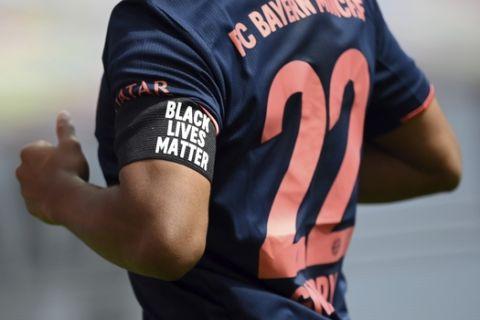 Serge Gnabry of Muenchen wears an armlet reading 'Black Lives Matter'  during the German Bundesliga soccer match between Bayer Leverkusen and Bayern Munich in Leverkusen, Germany, Saturday, June 6, 2020. (Matthias Hangst, Pool via AP)