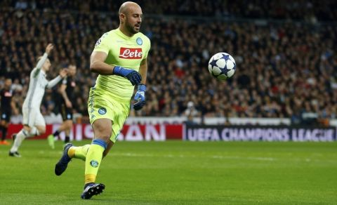 Napoli goalkeeper Pepe Reina runs after the ball during the Champions League round of 16, first leg, soccer match between Real Madrid and Napoli at the Santiago Bernabeu stadium in Madrid, Wednesday Feb. 15, 2017. (AP Photo/Francisco Seco)