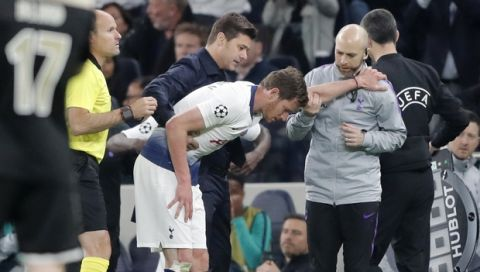 Tottenham's Jan Vertonghen walks off the pitch with a head injury during the Champions League semifinal first leg soccer match between Tottenham Hotspur and Ajax at the Tottenham Hotspur stadium in London, Tuesday, April 30, 2019. (AP Photo/Frank Augstein)