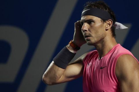 Spain's Rafael Nadal walks on the court in his men's final match against Taylor Fritz of the U.S. at the Mexican Tennis Open in Acapulco, Mexico, Saturday, Feb. 29, 2020. (AP Photo/Rebecca Blackwell)