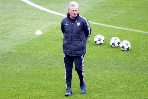 FILE - In this April 9, 2013 file photo Bayern Munich coach Jupp Heynckes leads a training session ahead of Wednesday's Champions League, round of eight, return-leg soccer match against Juventus, in Turin, Italy. (AP Photo/Massimo Pinca, file)