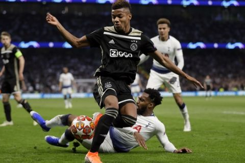 Ajax's David Neres, front, duels for the ball with Tottenham's Davinson Sanchez during the Champions League semifinal first leg soccer match between Tottenham Hotspur and Ajax at the Tottenham Hotspur stadium in London, Tuesday, April 30, 2019. (AP Photo/Kirsty Wigglesworth)