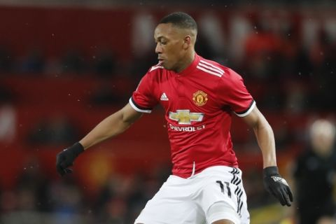 Manchester United's Anthony Martial during the English FA Cup quarterfinal soccer match between Manchester United and Brighton and Hove Albion at the Old Trafford stadium in Manchester, England, Saturday, March 17, 2018.(AP Photo/Frank Augstein)
