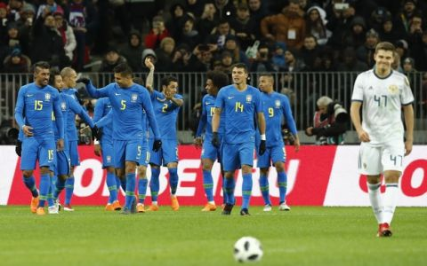 Russia's Roman Zobnin, right walks back after Brazil players celebrate after scoring the opening goal during an international friendly soccer match between Russia and Brazil at the Luzhniki stadium in Moscow, Russia, Friday, March 23, 2018. (AP Photo/Pavel Golovkin)