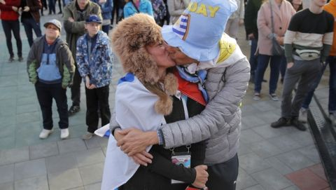 Uruguay fans kiss during the opening match of the 2018 soccer World Cup, between Russia and Saudi Arabia, in the fan zone in Yekaterinburg, Russia, Thursday, June 14, 2018. (AP Photo/Vadim Ghirda)
