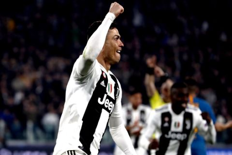 Juventus' Cristiano Ronaldo celebrates after scoring his side's second goal during the Champions League round of 16, 2nd leg, soccer match between Juventus and Atletico Madrid at the Allianz stadium in Turin, Italy, Tuesday, March 12, 2019. (AP Photo/Antonio Calanni)