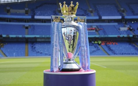 The Premier League trophy for Manchester City sits on the pitch prior to the English Premier League soccer match between Manchester City and Huddersfield Town at Etihad stadium in Manchester, England, Sunday, May 6, 2018. (AP Photo/Rui Vieira)