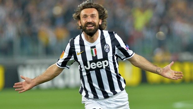 Juventus midfielder Andrea Pirlo  celebrates after scoring during the Europa League quarterfinal soccer match between Juventus and Olympic Lyon at the Juventus stadium, in Turin, Italy, Thursday, April 10, 2014. (AP Photo/ Massimo Pinca)