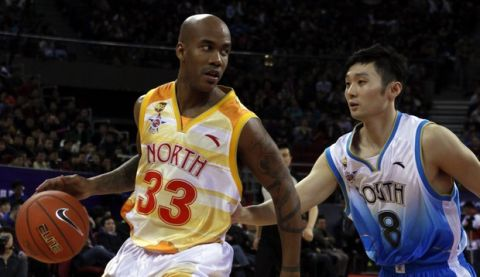 Stephon Marbury of China North team drives the ball down the court against Liu Wei of China South team, during the China Basketball Association's all star game, Beijing, China, Sunday, March 21, 2010. (AP Photo/ Gemunu Amarasinghe)