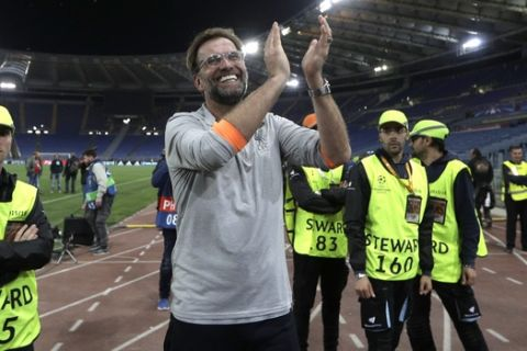 Liverpool coach Jurgen Klopp celebrates with the supporters at the end of the Champions League semifinal second leg soccer match between Roma and Liverpool at the Olympic Stadium in Rome, Wednesday, May 2, 2018. (AP Photo/Alessandra Tarantino)