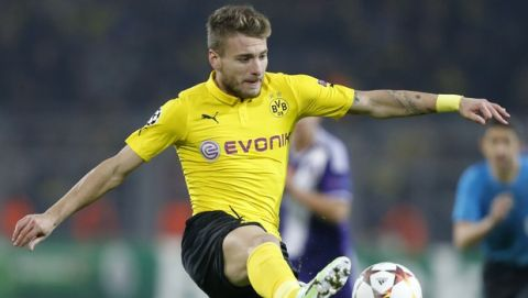Dortmund's Ciro Immobile controls the ball during the Group D Champions League soccer match between Dortmund and Anderlecht in Dortmund, Germany, Tuesday Dec. 9, 2014. (AP Photo/Frank Augstein)