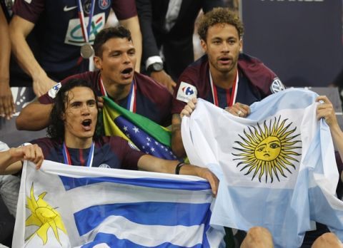 PSG's Thiago Silva, center, Edinson Cavani, left, and Neymar celebrate after the French Cup soccer final Paris Saint Germain against Les Herbiers at the Stade de France stadium in Saint-Denis, outside Paris, Tuesday, May 8, 2018. Paris Saint-Germain beat resilient third-division side Les Herbiers 2-0 to win the French Cup. (AP Photo/Francois Mori)