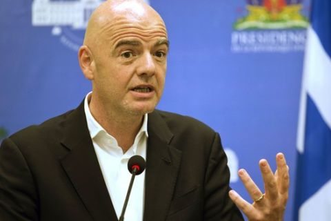 FILE - In this Saturday, April 29, 2017 file photo, FIFA President Gianni Infantino gives a press conference at the National Palace in Port-au-Prince, Haiti. Hundreds of prosecutions of suspected wrongdoing by soccer officials will be affected by President Gianni Infantino firing FIFA's top judge and prosecutor. The ousted investigator, Cornel Borbely, said Wednesday, May 10, 2017,  that the workload  heavier than even most FIFA critics imagined  of the ethics committee will be impeded by the firing that Infantino sprung on his ruling council a day earlier. (AP Photo/Dieu Nalio Chery, file)