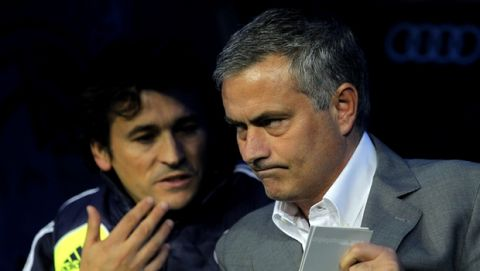 Real Madrid's coach Jose Mourinho from Portugal, right, and his assistant Rui Faria confer during a Spanish La Liga soccer match against Zaragoza at the Santiago Bernabeu stadium in Madrid, Spain, Saturday, Nov. 3, 2012. (AP Photo/Andres Kudacki)