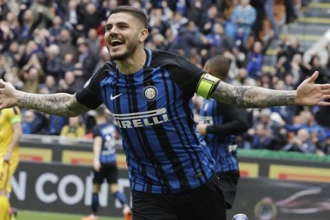 Inter Milan's Mauro Icardi celebrates after scoring the opening goal during a Serie A soccer match between Inter Milan and Hellas Verona, at the San Siro stadium in Milan, Italy, Saturday, March 31, 2018. (AP Photo/Luca Bruno)
