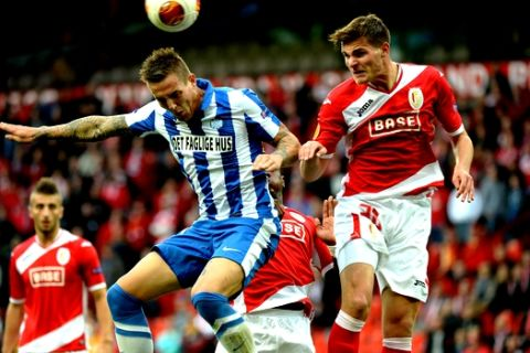 Standard de Liege's Dino Arslanagic, right, goes up against Esbjerg's Emil Lyng during the Europa League group stages in group C soccer, at the Maurice Dufrasne stadium in Liege, Belgium, Thursday, Sept. 19, 2013. (AP Photo/Geert Vanden Wijngaert)