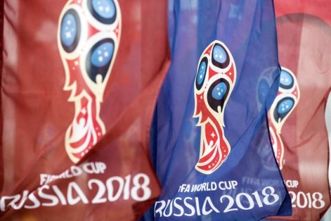 Flags with the logo for the 2018 FIFA World Cup flutter in the wind near the World Cup stadium in Rostov-on-Don before the Russian premier league soccer match between Rostov and Ural, in Rostov-on-Don, Russia, Sunday, May 13, 2018. (AP Photo/Pavel Golovkin)