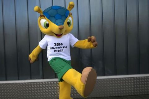 FILE - In this Oct. 16, 2012 file photo, the armadillo mascot for the 2014 World Cup in Brazil poses for photographs outside the Brand Licensing Europe 2012 exposition at Olympia in London.  The Brazilian government will begin a program meant to save the endangered armadillo, the mascot for this year's World Cup, the Environment Ministry said Tuesday, Feb. 11, 2014.  (AP Photo/Matt Dunham, File)
