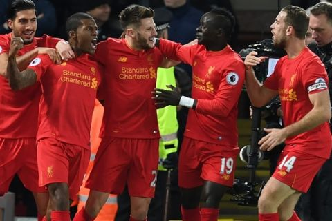 Liverpool's Dutch midfielder Georginio Wijnaldum (2nd L) celebrates with teammates after scoring the opening goal of the English Premier League football match between Liverpool and Manchester City at Anfield in Liverpool, north west England on December 31, 2016. / AFP / Paul ELLIS / RESTRICTED TO EDITORIAL USE. No use with unauthorized audio, video, data, fixture lists, club/league logos or 'live' services. Online in-match use limited to 75 images, no video emulation. No use in betting, games or single club/league/player publications.  /         (Photo credit should read PAUL ELLIS/AFP/Getty Images)