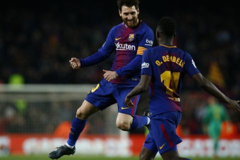 FC Barcelona's Lionel Messi celebrates after scoring with his teammate Dembele during the Spanish La Liga soccer match between FC Barcelona and Girona at the Camp Nou stadium in Barcelona, Spain, Saturday, Feb. 24, 2018. (AP Photo/Manu Fernandez)