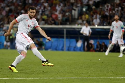 Spain's Nacho scores his side's third goal during the group B match between Portugal and Spain at the 2018 soccer World Cup in the Fisht Stadium in Sochi, Russia, Friday, June 15, 2018. (AP Photo/Frank Augstein)
