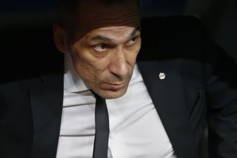 APOEL Nicosia coach Giorgos Donis looks out from the bench before a Champions League group H soccer match between Real Madrid and Apoel Nicosia at the Santiago Bernabeu stadium in Madrid, Spain, Wednesday, Sept. 13, 2017. (AP Photo/Paul White)