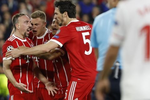 Bayern's Franck Ribery, left, celebrates with team mates after scoring his side's opening goal during the Champions League quarter final first leg soccer match between Sevilla FC and FC Bayern Munich at the Sanchez Pizjuan stadium in Seville, Spain, Tuesday, April 3, 2018. (AP Photo/Miguel Morenatti)