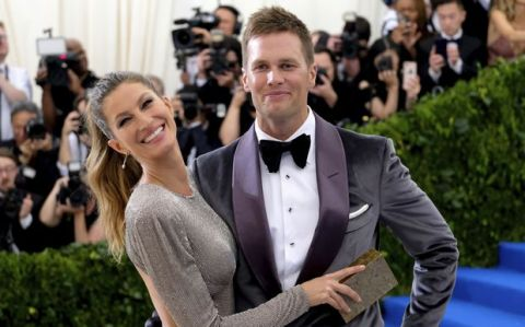 """FILE - In this May 1, 2017, file photo, Gisele Bundchen and Tom Brady attend an event at The Metropolitan Museum of Art in New York. The NFL and the players union have found no evidence of deviation by New Englands medical staff from the leagues concussion protocol regarding Tom Brady last season. League spokesman Brian McCarthy said in a statement Wednesday, Sept. 6,2017, that Brady released his medical records for review as part of the process. McCarthy said the review also identified no evidence that Brady sustained a concussion or reported signs or symptoms consistent with one in 2016. Brady's wife, supermodel Gisele Bundchen, told """"CBS This Morning"""" in May that Brady played through a concussion on his way to a fifth Super Bowl title.(Photo by Charles Sykes/Invision/AP, File)"""