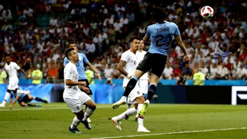 Uruguay's Edinson Cavani scores the opening goal during the round of 16 match between Uruguay and Portugal at the 2018 soccer World Cup at the Fisht Stadium in Sochi, Russia, Saturday, June 30, 2018. (AP Photo/Francisco Seco)