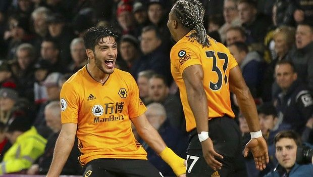 Wolverhampton Wanderers' Raul Jimenez, left,  celebrates scoring his side's second goal of the game with Adama Traoreduring the English Premier League soccer match between Bournemouth and Wolverhampton Wanderers, at the Vitality Stadium, in Bournemouth, England, Saturday, Nov. 23, 2019. (Mark Kerton/PA via AP)