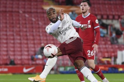 Arsenal's Alexandre Lacazette scores his team's first goal during the English Premier League soccer match between Liverpool and Arsenal at Anfield in Liverpool, England, Monday, Sept. 28, 2020. (Laurence Griffiths/Pool via AP)