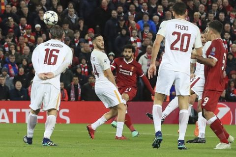 Liverpool's Mohamed Salah, center, scores the opening goal against Roma during their Champions League, Semifinal first leg soccer match at Anfield, Liverpool, England, Tuesday April 24, 2018. (Peter Byrne/PA via AP)