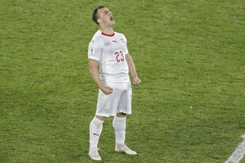 Switzerland's Xherdan Shaqiri celebrates after scoring his side's second goal during the group E match between Switzerland and Serbia at the 2018 soccer World Cup in the Kaliningrad Stadium in Kaliningrad, Russia, Friday, June 22, 2018. Shaqiri scored once in Switzerland's 2-1 victory. (AP Photo/Antonio Calanni)