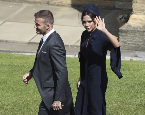 David and Victoria Beckham arrive for the wedding ceremony of Prince Harry and Meghan Markle at St. George's Chapel in Windsor Castle in Windsor, near London, England, Saturday, May 19, 2018. (Andrew Milligan/pool photo via AP)