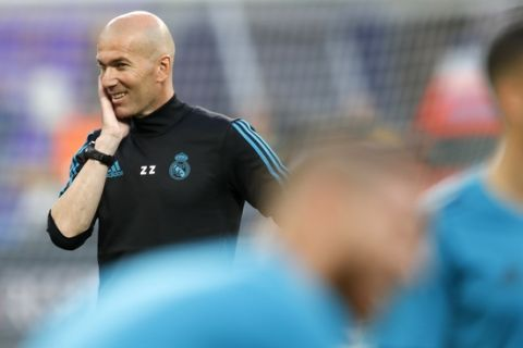 Real Madrid coach Zinedine Zidane smiles during a training session at the Olimpiyskiy Stadium in Kiev, Ukraine, Friday, May 25, 2018 ahead of the Champions League final soccer match between Real Madrid and Liverpool on Saturday May 26. (AP Photo/Pavel Golovkin)