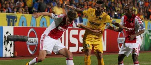 Ajax Amsterdam's Lucas Andersen (L) fights for the ball against APOEL Nicosia's Mario Aloneftis (C) during their group F UEFA Champions League football match in the Cypriot capital Nicosia on September 30, 2014. AFP PHOTO/Yiannis Kourtoglou        (Photo credit should read Yiannis Kourtoglou/AFP/Getty Images)