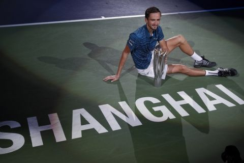 In this Sunday, Oct. 13, 2019, file photo, Daniil Medvedev of Russia poses with his winner's trophy on the court after defeating Alexander Zverev of Germany in the men's final at the Shanghai Masters tennis tournament at Qizhong Forest Sports City Tennis Center in Shanghai, China. (AP Photo/Andy Wong, File)