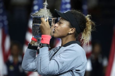 Naomi Osaka, of Japan, kisses the trophy after defeating Serena Williams in the women's final of the U.S. Open tennis tournament, Saturday, Sept. 8, 2018, in New York. (AP Photo/Julio Cortez)