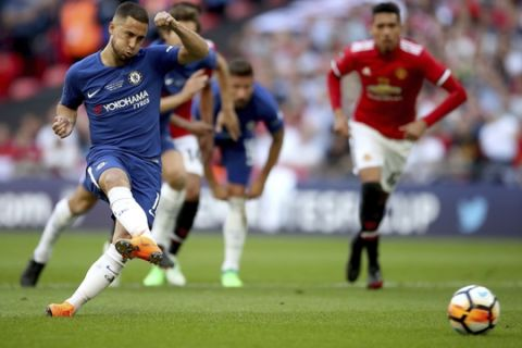 Chelsea's Eden Hazard scores from the penalty spot during the Emirates FA Cup Final against Manchester United at Wembley Stadium, Saturday, May 19, 2018, in London. (Nick Potts/PA via AP)