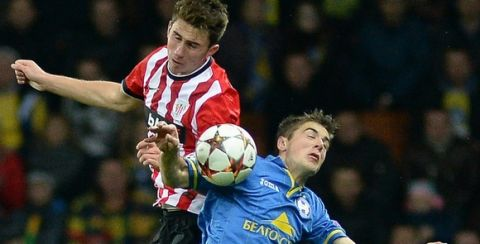 Bate Borisovs Aleksandr Karnitski (R) fights for the ball with Athletic Bilbaos Aymeric Laporte on September 30, 2014 during a UEFA Champions League group H football match between Bate Borisov and Athletic Bilbao in Minsk.   AFP PHOTO / MAXIM MALINOVSKY.        (Photo credit should read MAXIM MALINOVSKY/AFP/Getty Images)