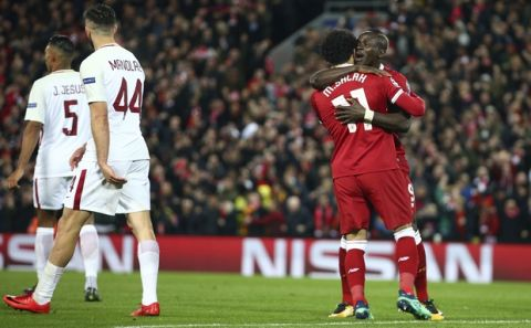 Liverpool's Sadio Mane, right, celebrates with Mohamed Salah after scoring his side's third goal during the Champions League semifinal, first leg, soccer match between Liverpool and AS Roma at Anfield Stadium, Liverpool, England, Tuesday, April 24, 2018. (AP Photo/Dave Thompson)