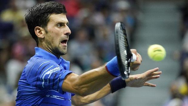 Novak Djokovic, of Serbia, returns to Stan Wawrinka, of Switzerland, during the fourth round of the U.S. Open tennis championships, Sunday, Sept. 1, 2019, in New York. (AP Photo/Eduardo Munoz Alvarez)