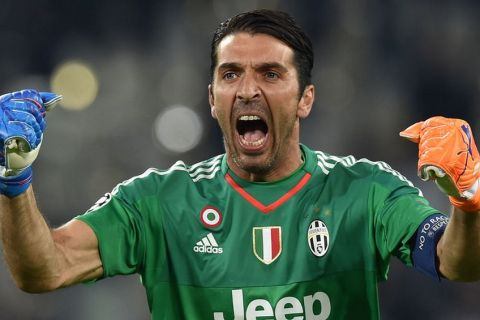 TURIN, ITALY - SEPTEMBER 30:  Gianluigi Buffon of Juventus celebrates after his team-mate Alvaro Morata scored the opening goal during the UEFA Champions League group E match between Juventus and Sevilla FC on September 30, 2015 in Turin, Italy.  (Photo by Valerio Pennicino/Getty Images)