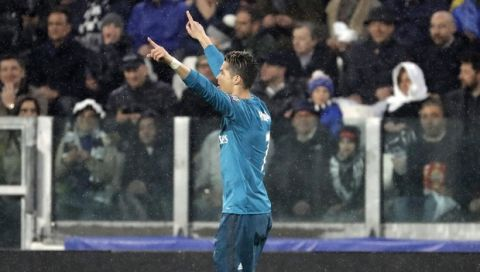 Real Madrid's Cristiano Ronaldo celebrates after scoring the opening goal of his team during the Champions League, round of 8, first-leg soccer match between Juventus and Real Madrid at the Allianz stadium in Turin, Italy, Tuesday, April 3, 2018. (AP Photo/Luca Bruno)