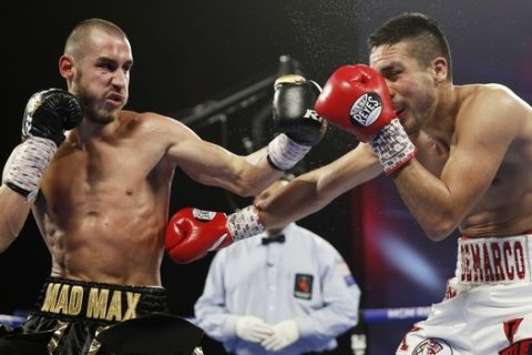 Maxim Dadashev hits Antonio DeMarco, of Mexico, during a junior welterweight bout Saturday, Oct. 20, 2018, in Las Vegas. (AP Photo/John Locher)