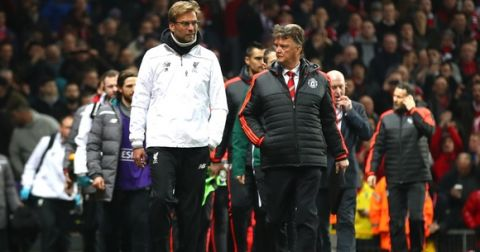 """""""MANCHESTER, ENGLAND - MARCH 17:  Louis van Gaal Manager of Manchester United and Jurgen Klopp manager of Liverpool walk along the touchline prior to the UEFA Europa League round of 16, second leg match between Manchester United and Liverpool at Old Trafford on March 17, 2016 in Manchester, England.  (Photo by Clive Brunskill/Getty Images)"""""""