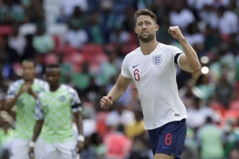 England's Gary Cahill celebrates after scoring the opening goal during a friendly soccer match between England and Nigeria at Wembley stadium in London, Saturday, June 2, 2018. (AP Photo/Matt Dunham)