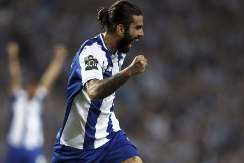 Porto's Sergio Oliveira celebrates after scoring the opening goal during the Portuguese league soccer match between FC Porto and Feirense at the Dragao stadium in Porto, Portugal, Sunday, May 6, 2018. Porto clinched the league title Saturday night, two rounds before the end, when Benfica and Sporting CP tied 0-0 in their Lisbon derby. (AP Photo/Luis Vieira)